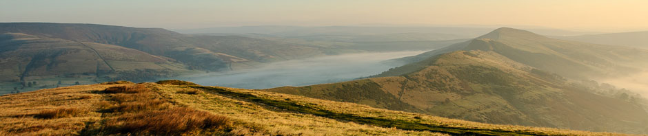 A misty dawn landscape in the Peak District